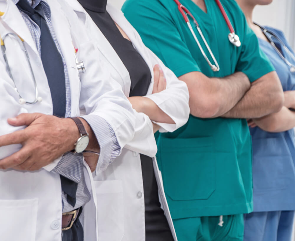 Doctors with arms folded