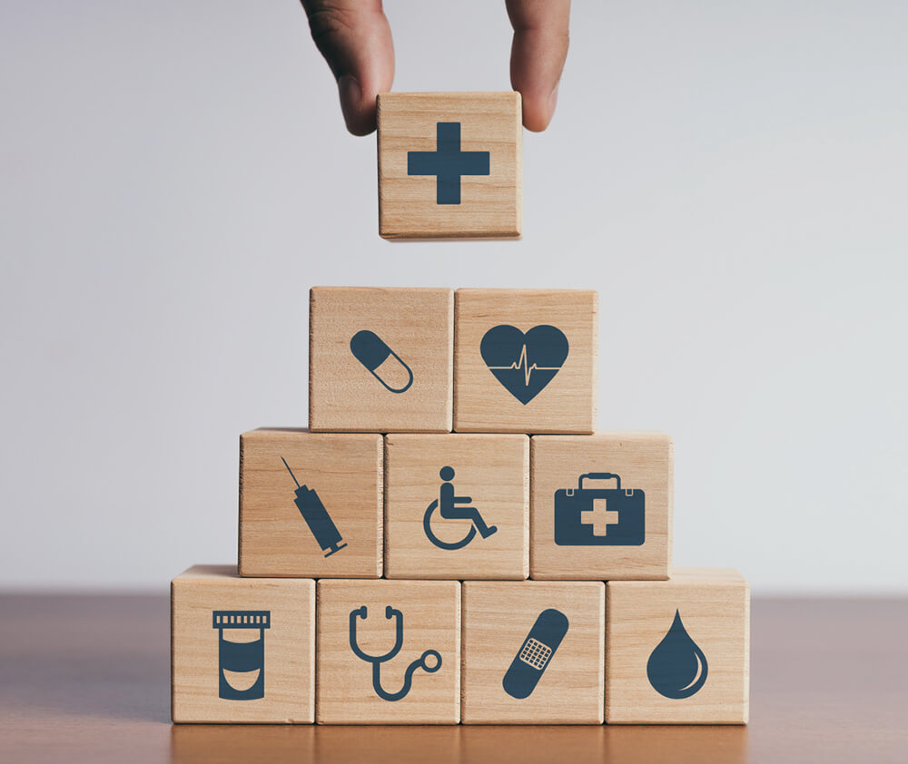 Hospital icons engraved on wooden blocks