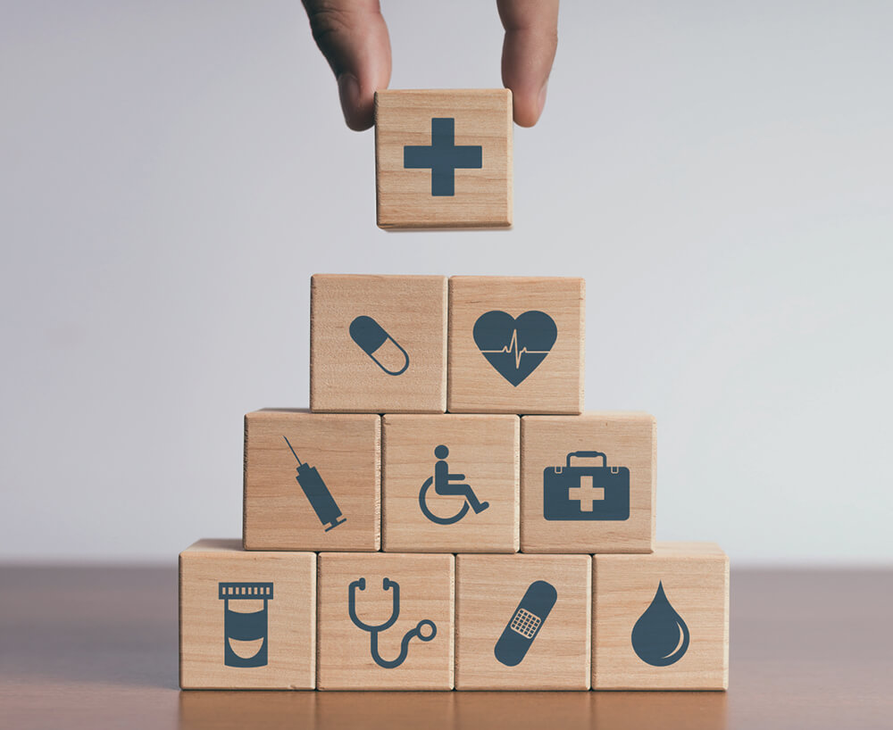 Wooden blocks stamped with hospital-related icons